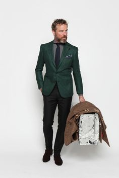 Nothing says bold like a green blazer and a gray beard.