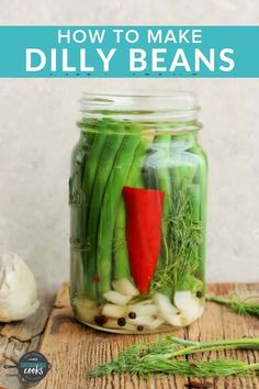 "Learn the secrets of how to make amazing Refrigerator Dilly Beans. This easy recipe for pickled beans involves zero canning and will help you ""put up"" the summer bounty in a delicious and snackable way. #dillybeans #fridgepickles #greenbeanrecipes #canning"