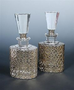 Cal Howard for Garrard, a pair of crystal and silver gilt perfume bottles,
