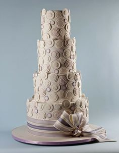 Geometric circle Wedding Cake I The People's Cake I See more: http://www.weddingwire.com/biz/the-peoples-cake-seattle/portfolio/ae81bf78c1782975.html?page=4&subtab=album&albumId=1785a3d70ce3be8f#vendor-storefront-content