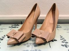 $88 Nude Pumps with Bow via boutiika.com I have the flat version of these and I love them.