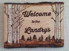 This rustic wood burned Welcome sign with painted white birch trees is the perfect greeting for your friends and family. It can be customized with your family name or any saying you would like. It would look great at the front door of your home, country cottage or at your cabin in the woods.  The woodburning is done on barked basswood and measures 13 x 10 x 5/8. It has been sealed with polyurethane for use indoors or outdoors. It comes with a sawtooth hanger or with a couple of eye hooks...