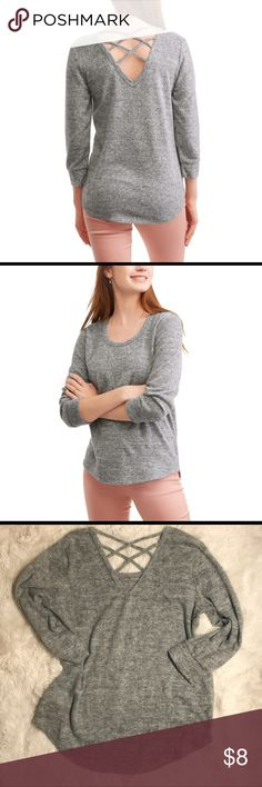 NO BOUNDARIES CROSS BACK RAGLAN SLEEVE TUNIC No Boundaries cross back pullover. This simple yet fashionable top will be the must-have item in your closet this season! Made with a soft knit fabric, this pullover sports a double cross back to show off your fun side. Get it solid or get it printed -it's available in assorted styles. Wear this pullover with a pair of jeans or jeggings... or tuck it into a cute skirt for a more feminine look.  Poly/Rayon/Spandex Blend  Heather Brushed Hacci…
