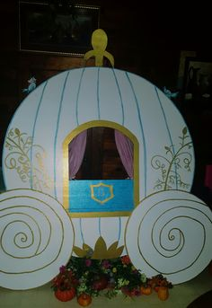 Cinderella carriage made for daughter's 6th birthday party. Made from foam board bought from Lowes. Hand painted with acrylic paint. Tablecloth from Walmart used to make curtain. Printed on cardstock paper - bluebirds and mice from Cinderella movie.