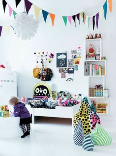 Scandinavian/colourful room.White floors, walls and furniture. Colourful textiles. Dots. Lots of pillows. Clouds.