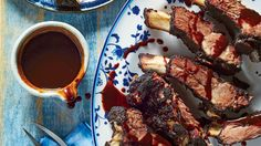 A sweet cola barbecue sauce balances out the earthy, peppery dry rub on these deliciously rich ribs. Serve with a tangy side dish, like a vinegar-based coleslaw or potato salad.
