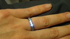 Induction-powered LED wedding ring lights up when couple holds hands