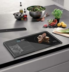 Touchscreen cutting board that can give you recipes, weigh what you're chopping and even tell you when it's clean enough! Brilliant!