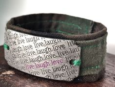 Green Camouflage bracelet handcrafted out of donated military uniform with Live, Love, Laugh shield by ValorBands on Etsy  #MedalsofHonor #ValorBands