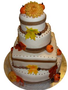 Fall harvest cake with edible leaves and mini pumpkins wedding cake