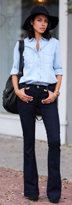 Black Mid Rise Flare Jeans by Vivaluxury.