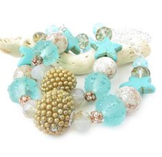 These curtain tiebacks have beautiful beach colors which will add the beauty of the ocean colors to your shabby chic decor. These add a beautiful cottage chic beach decor to your home. There is a strong shiny silver chain attached to ends for easy hanging. These beaded curtain tiebacks features beads of turquoise and gold to add a sparkle to your curtains These are sure to add the beach and ocean theme to any beach cottage or beach home decor. These starfish curtain tiebacks measure 18…