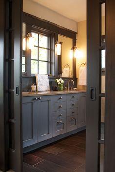 """Split pocket doors (""""French""""??) to replace door between master bedroom and master bath."""