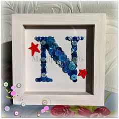 Boys button initial box framed