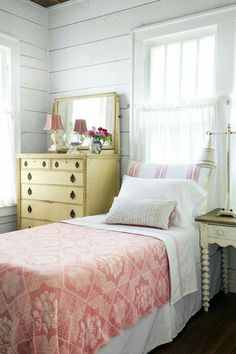 Pretty Vintage Country Bedroom with Painted Chest of Drawers, Vintage Counterpane and Lace at the Window.