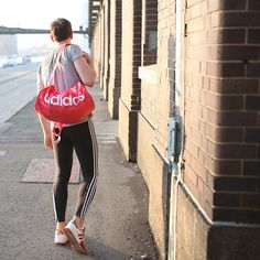Get this look: http://lb.nu/look/8585225  More looks by Nico Hagenburger: http://lb.nu/hagenburger  Items in this look:  Adidas Shakers, Adidas 3 Stripes Tights, Adidas Pink Bag, Adidas Rita Ora Shirt   #sporty #street #adidas #adidasoriginals #bag #pink #sneakers #tights #leggings