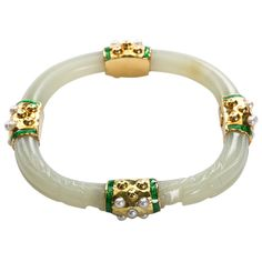 David Webb Carved Jade Bangle | From a unique collection of vintage bangles at http://www.1stdibs.com/jewelry/bracelets/bangles/