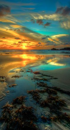 Flame and Blue ~ sunset and calm seas by the breakwater in Bude, north Cornwall, England | photo: Mike Pratt