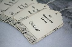 Sheet Music Escort Cards. Show your guests to their table with these custom sheet music escort card hang tags.  Hang them from signs, frames, branches to escort your guests into the reception.