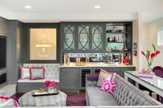 Glamorous gray contemporary living room with pink accents