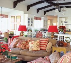 Mary McDonald - sitting room off kitchen - red, blue, khaki and white, great beams