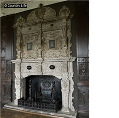The 17th century Jacobean fireplace inlaid with polished marble in the long gallery at Aston Hall in Birmingham West Midlands England.