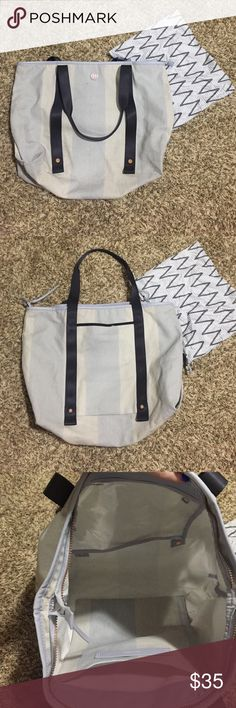 Lululemon Summer Lovin' Tote Cotton canvas fabric tote. Unsnap the front straps to securely store your mat or towel, internal vented picket that is easy to wipe clean, can hold up to 50lbs. lululemon athletica Bags Totes