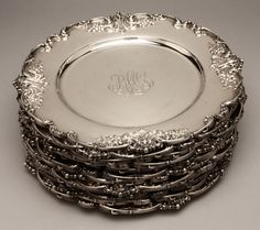 Lot# 1147 A set of twelve Redlich sterling silver plates. est: $3500/5000 *Price Realized: $4,312.50