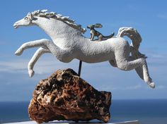"""Carol Hayward Fell - South Africa. """"Leaping Horse with Long-eared Dog""""  High fired Stoneware and porcelain clay, South African igneous volcanic rock and stainless steel."""