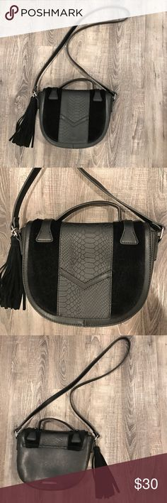 BCBGeneration Crossbody Bag Medium sized faux embossed leather and faux pony hair crossbody Handbag with tassel, strap and inside zipper compartment and magnetic snap front closure BCBGeneration Bags Crossbody Bags