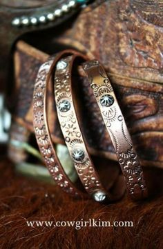 Vintage Revival Copper Cuff Bracelets -  THE FIRST FEATURES HAND TOOLING IN A NATIVE AMERICAN MOTIF. THE SECOND ADDS ONE STERLING SILVER ROSETTE CONCHO BUTTON AT THE CENTER, AND THE THIRD ADDS 5 ROSETTES IN STERLING.  LOOKS GREAT AS A STACK ON THE WRIST,  when ss added price goes up $50+ on top of $38 for copper bracelet