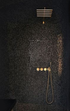 CONTEMPORARY vibe from black mosaic tiles cantilevered black seat simple lines minimalist look. GLAM factor from glossy-finished gray mosaic tiles that reflect light gold-finished rain shower & shower controls. Black Shower, Gold Shower, Black Tiles, Wet Rooms, Beautiful Bathrooms, Luxurious Bathrooms, Bathroom Interior, Design Bathroom, Tile Design