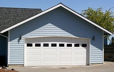 Cost to Build an Attached Garage - Estimates and Prices at Fixr Garage Door Windows, Garage Door Repair, Car Garage, Building A Garage, Garage Addition, Roller Doors, Cost To Build, Attached Garage, Wood Shed