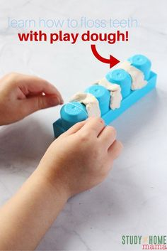 Learn how to floss teeth with play dough and Duplo/Megablocks! This is a great fine motor activity for kids and a great one for learning about dental hygiene. A tooth activity perfect for dental health month!