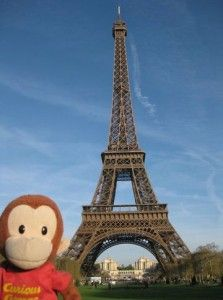 George at the Eiffel Tower in Paris, France. George is curious about learning French too!