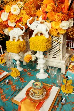 Amazing blue and yellow themed indian wedding with cute elephant centerpieces