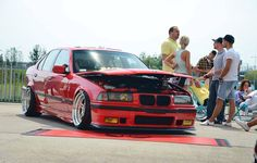 Hellrot BMW e36 sedan on culture classic OZ AC Schnitzer type I wheels