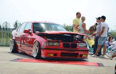 Hellrot BMW e36 sedan on culture classic OZ AC Schnitzer type I wheels