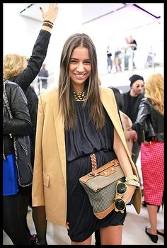 all my faves - black, camel, pleats, clutch, gold accessories, belt