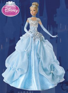 This breathtaking Cinderella princess doll is Ashton-Drake's first-ever Disney Princess portrait doll to wear a gown embellished with glittering Diamonesk® stones.