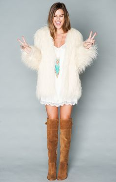 "The bohemia fur jacket will turn anything your wearing into the ultimate boho chic outfit. She is more than just fashion, she functions as a cold weather fighter in all that wild fur.														 														 *I Come in Four Sizes: XS, S, M, L  *Basically Wrinkle-proof.  Throw in purse for later recommended																									  Natalie is 5'6"" her measurements are 34-24-34 and she is wearing a small."
