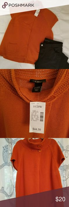 NWT Lane Bryant 18/20W Orange Sleeveless Sweater Condition: NWT  Brand: Lane Bryant Color Burnt Orange  Size: 18/20W  Gorgeous fall sleeveless sweater in size 18/20W. Two pockets in the front. The sweater buttons at the neck with two buttons and is open the rest of the way. Pairs beautifully with a pair of boot cut jeans, long sleeved white shirt, and cute pair of boots.   Smoke Free home. Lane Bryant Sweaters