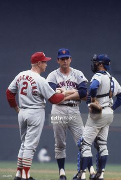 Red Schoendienst, Jerry Koosman, and Randy Hundley meet on mound during the All Star Game at Robert F. Kennedy Stadium in Washington, D.C. in 1969.
