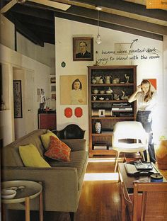 I love the pictures on the wall and the collection on the bookcase