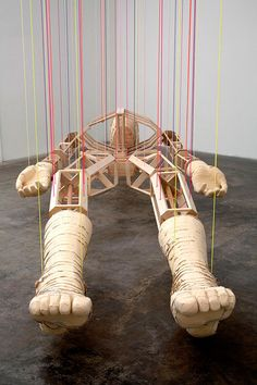 """Clark Goolsby, """"Dead Man"""", wood, foam, OSB, brass, string and rope, 36 x 84 x 216 inches"""
