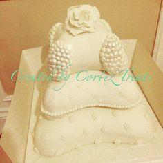 3-tier ivory pillow cake created by #CortezTreats #wedding #weddingcake #pillowcake #florals #ivory #pearls #love #londonweddings