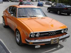 Awesome orange Audi 100 coupe.