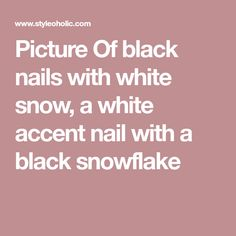 Picture Of black nails with white snow, a white accent nail with a black snowflake