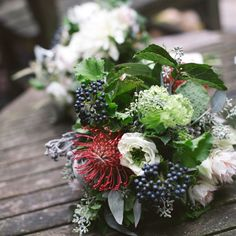 Pretty pincushion Protea bouquet with berried Viburnum, seeded eucalyptus and Blushing Bride. Beautiful!