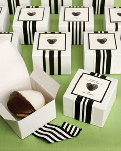 Boxed black-and-white cookies topped with thumbprint heart labels and graphic ribbon also served as parting gifts.